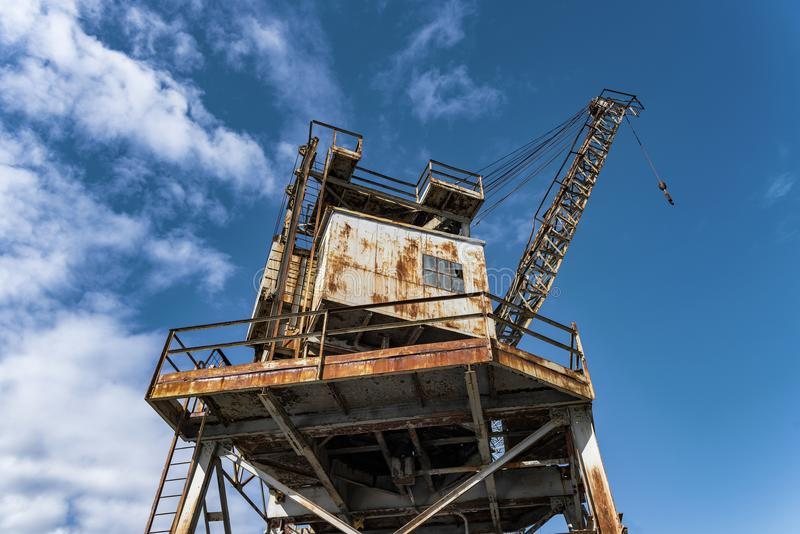 Tower of strength and bygone engineering. A tower of strength and bygone engineering is demonstrated by a historic industrial cargo crane on Cockatoo Island royalty free stock images