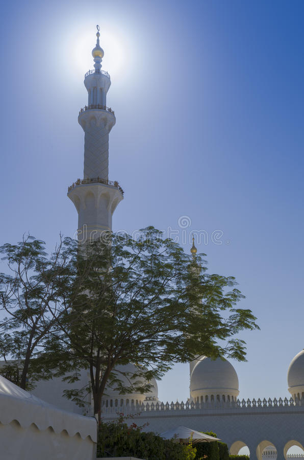 Tower at the stunning Sheikh Zayed Grand Mosque in Abu Dhabi UAE. Sunlit Mineret on the beautiful Sheikh Zayed Grand Mosque in Abu Dhabi United Arab Emirates royalty free stock photography