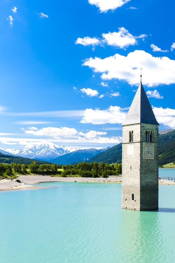 Tower of sunken church in Resia lake, South Tyrol, Italy royalty free stock photography