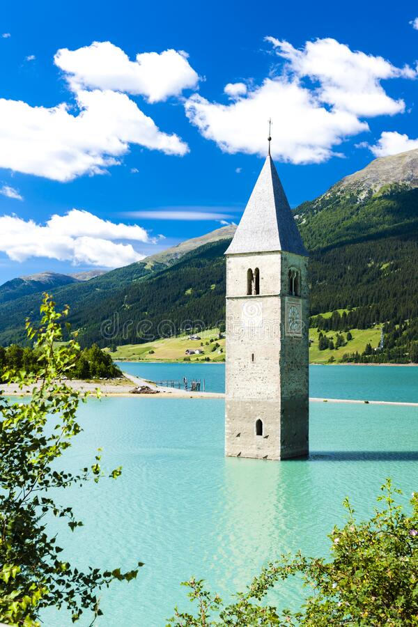 Tower of sunken church in Resia lake, South Tyrol, Italy royalty free stock images