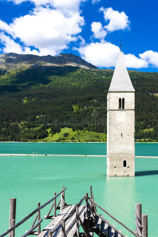 Tower of sunken church in Resia lake, South Tyrol, Italy stock image