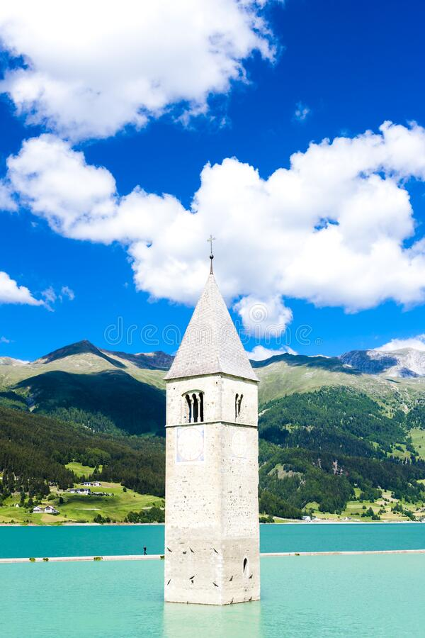 Tower of sunken church in Resia lake, South Tyrol, Italy royalty free stock photos