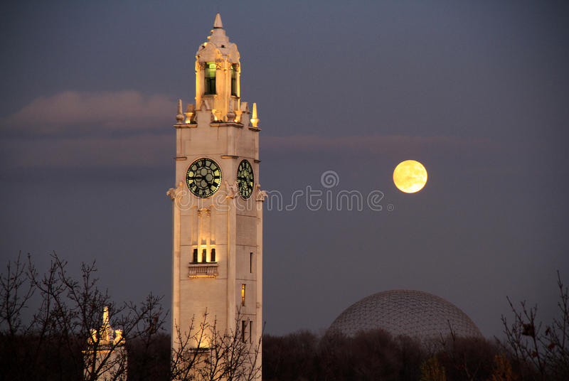 Tower and super moon. Watching super moon at the old harbor of Montreal royalty free stock photo