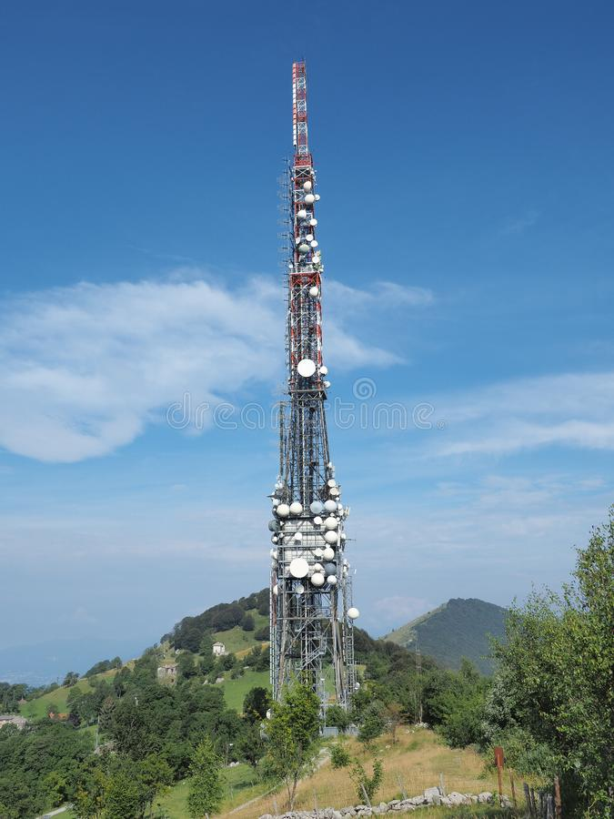 Tower for telecommunications, television broadcast, cellphone, radio and satellite on Linzone mountain peak royalty free stock image