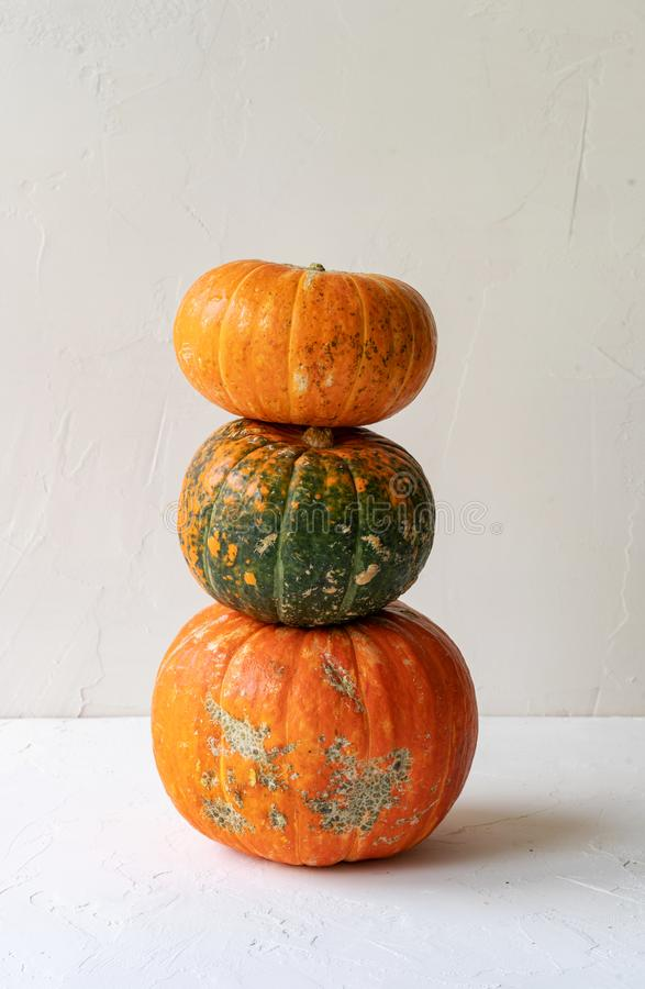 Tower of three whole pumpkins royalty free stock image