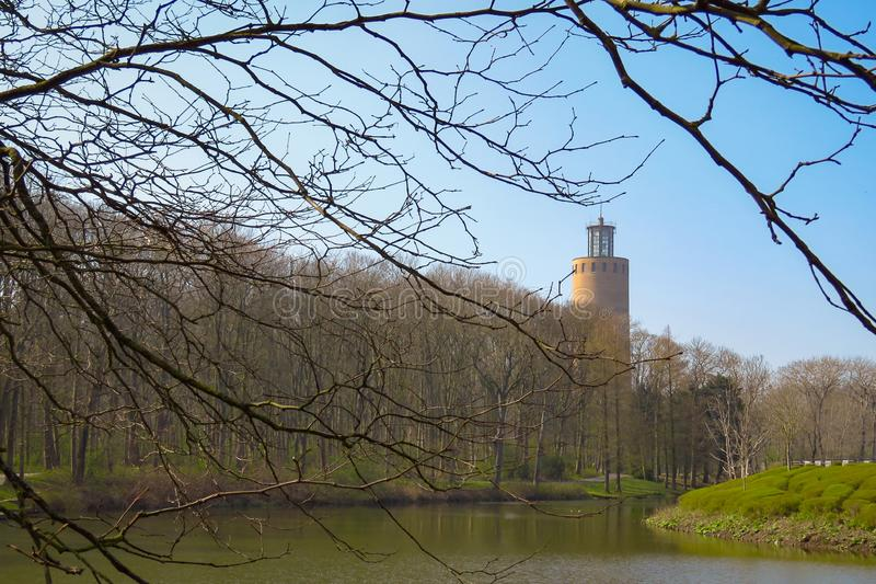 Tower, trees and pond, Maria Hendrika Park, Ostend, Belgium royalty free stock photos