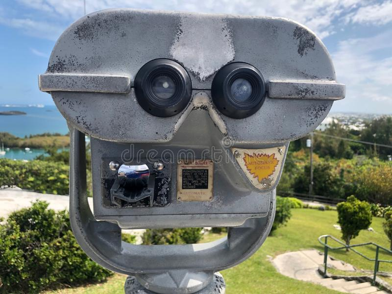 Bermuda,Binoculars on the panoramic tower. A tower viewer is a telescope or binoculars permanently mounted on a stalk. The device magnifies objects seen through royalty free stock photos