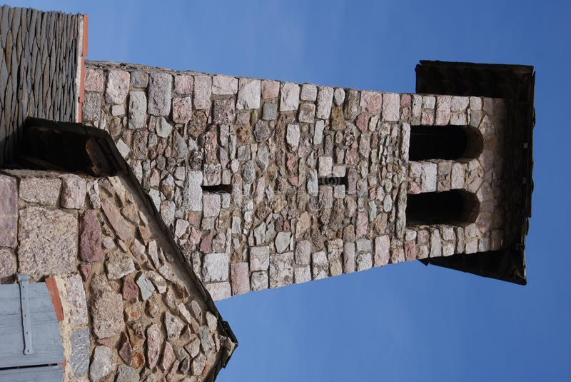 Tower at Villefrance-de-Conflent. Tower with two windows at villefranche-de-Conflent and a blue sky royalty free stock photography