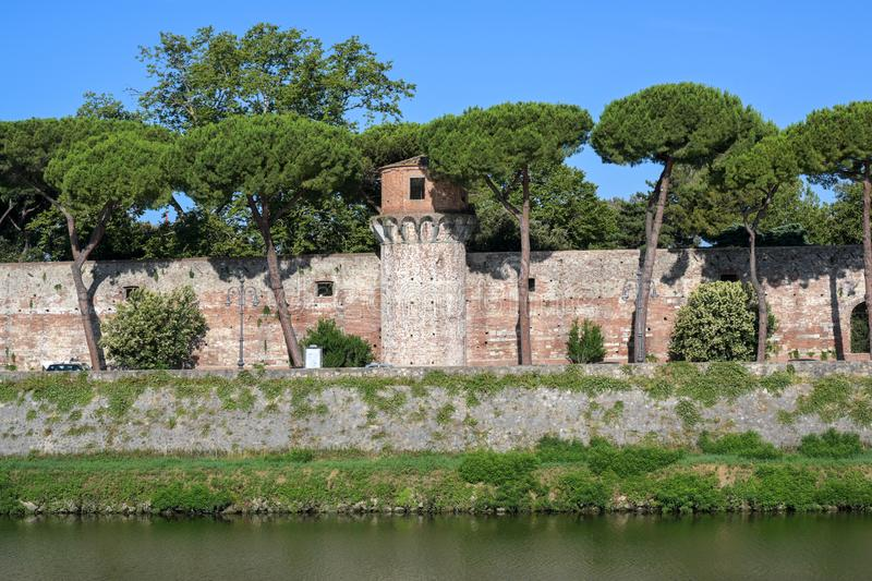 Tower and wall of the Cittadella Nuova New Citadel, now called Giardino Scotto Scotto`s Garden an old fortress in Pisa at the. River Arno, Italy stock image