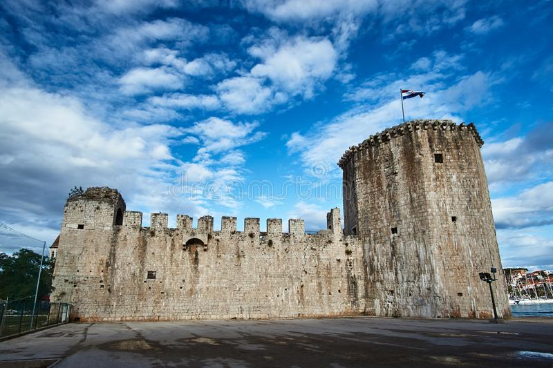 Tower and walls of Venetian fortress in the town of Trogir stock photography