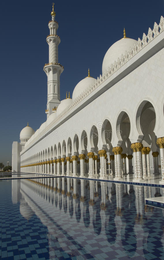 Tower, water pool and arches at the stunning Sheikh Zayed Grand Mosque in Abu Dhabi UAE. Fountain pool, Mineret and arches at the beautiful Sheikh Zayed Grand stock photography