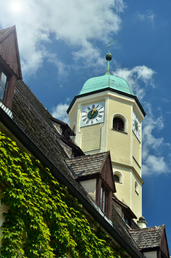 Tower in Weiden, Germany. Church Tower in Weiden, Germany with sky background, cuprum roof on tower, wooden roof next the church stock image