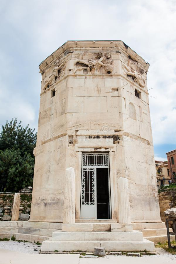 Tower of the Winds an octagonal Pentelic marble clocktower in the Roman Agora in Athens constructed in the 2nd century BC. Tower of the Winds or the Horologion royalty free stock photos