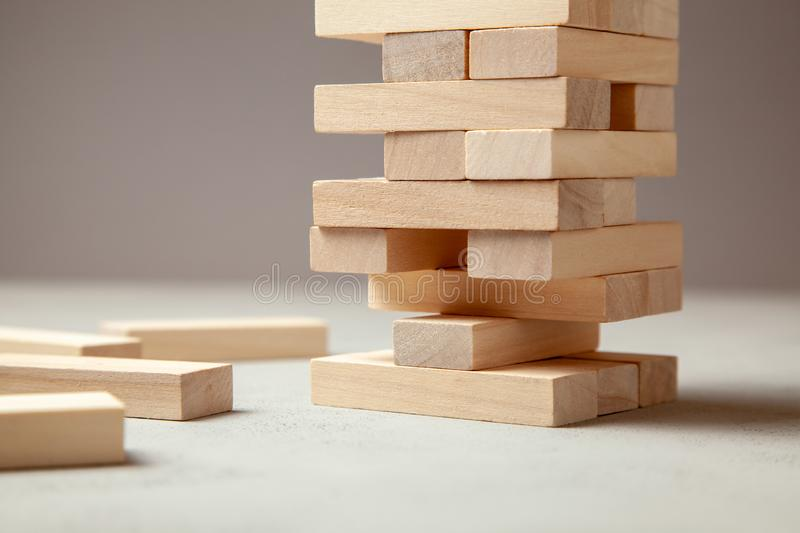 Tower of wooden blocks on gray background. Board game for the whole family or party. Concept of building business or building team royalty free stock photo