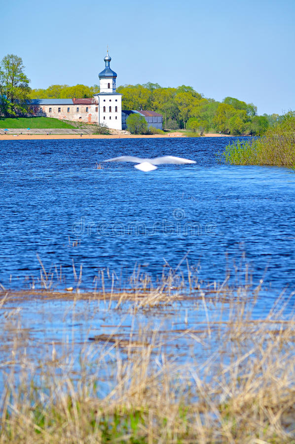 The tower of Yuriev male monastery on the bank of the Volkhov river in Veliky Novgorod, Russia royalty free stock image