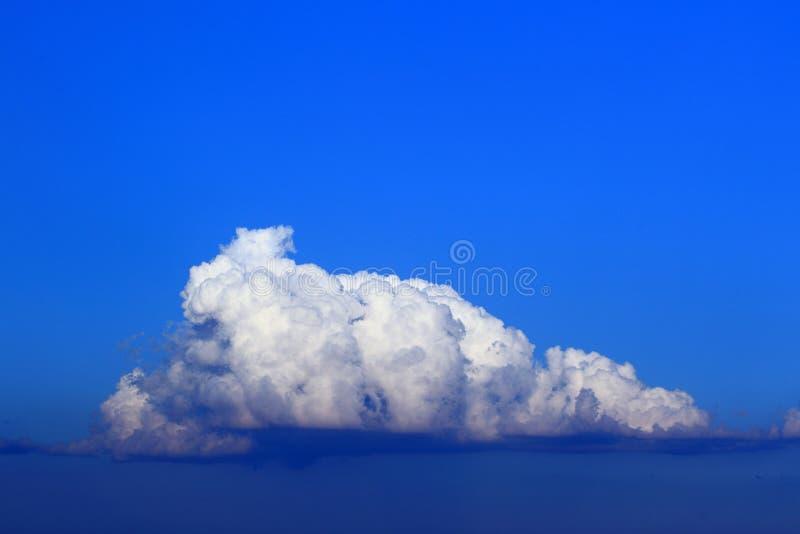 Towering cumulus cloud. The single towering cumulus cloud on the sky stock photos