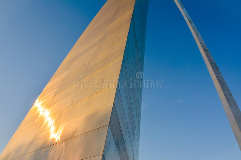 Towering Gateway Arch. The metal surface glitters in the sun set of the elegant, giant and majestic Gateway Arch in St Louis, Missouri. An architectural landmark royalty free stock photo