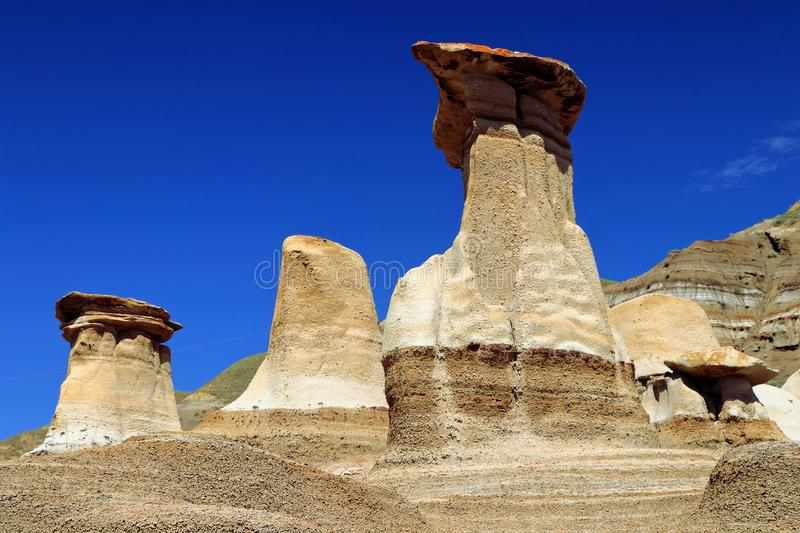 Striking Hoodoos in the Red River Badlands at East Coulee near Drumheller, Alberta, Canada stock photo