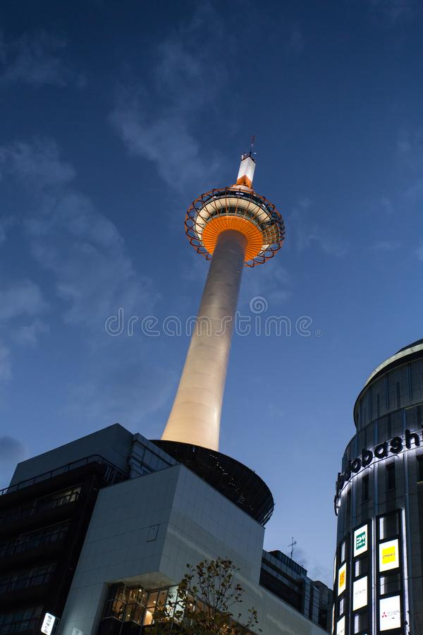 Kyoto Tower at Dusk, Japan. The towering Kyoto Tower, taken from its base at dusk when the light is turned on. The tower is used for observation platform, and it royalty free stock images