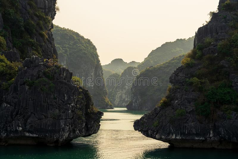 Towering Limestone of Ha Long Bay. Hạ Long Bay, in northeast Vietnam, is known for its emerald waters and thousands of towering limestone islands topped by royalty free stock image