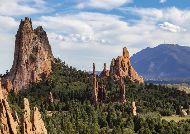 The towering red rock formations of the Garden of the Gods of Colorado Springs with Cheyenne Mountain in the background.  royalty free stock images