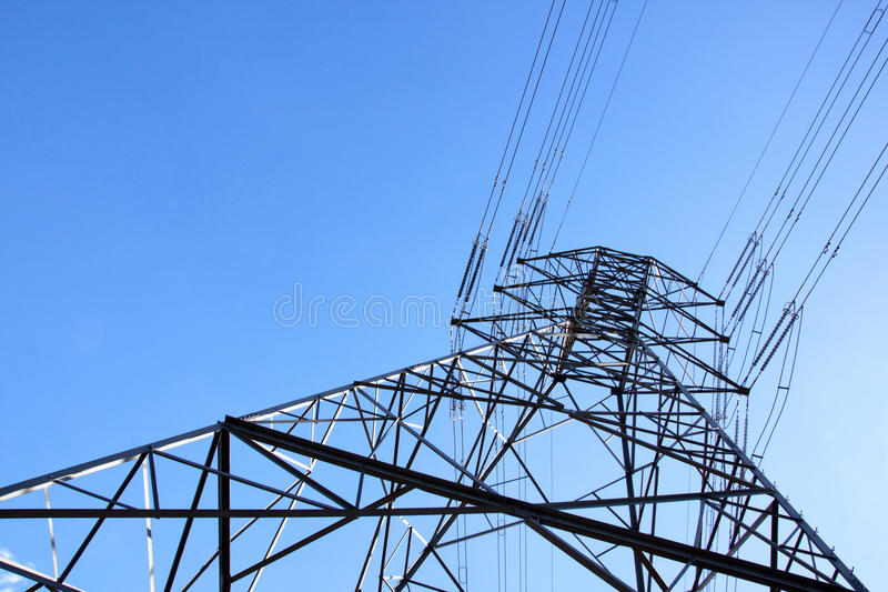 Towering Steel Pylon Supporting Electric Power Cables stock photo