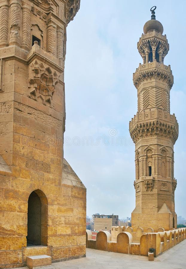 The towers of Bab Zuwayla Gate, Cairo, Egypt. The picturesque towers of medieval Bab Zuwayla Gate, decorated with complex carved patterns, Cairo, Egypt stock photography