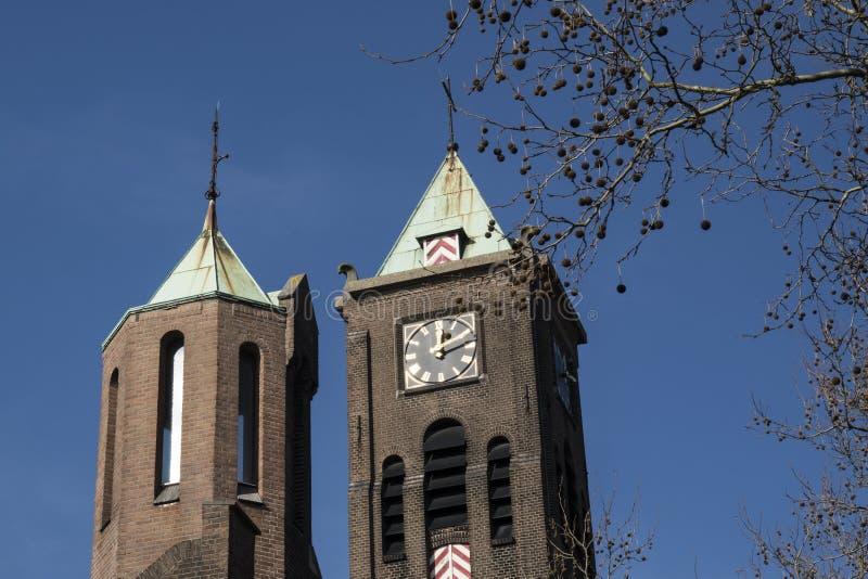 Church Wilhelminakerk in Dordrecht, The Netherlands. Towers of church Wilhelminakerk in Dordrecht, The Netherlands stock photo