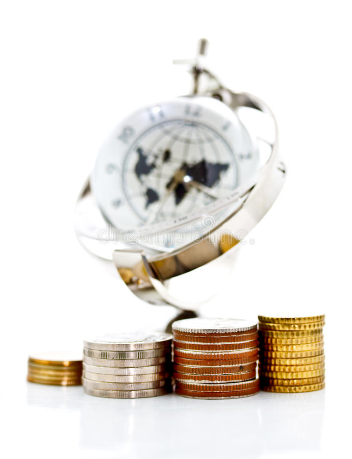 Towers of coins and global model clock stock images