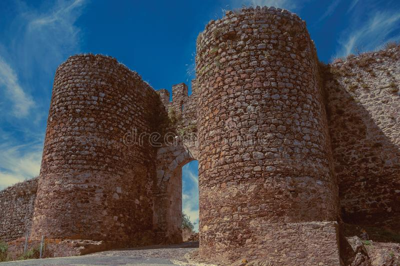 Towers beside the doorway of Evoramonte. Stone thick towers in a sunny day beside the entrance doorway on the outer wall of Evoramonte. A tiny fortified civil royalty free stock photos