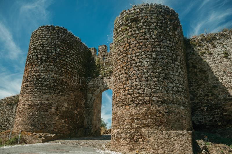 Towers beside the doorway of Evoramonte. Stone thick towers in a sunny day beside the main entrance doorway on the outer wall of Evoramonte. A tiny fortified royalty free stock photos