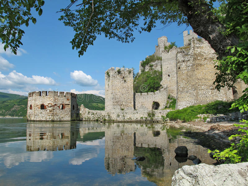 Towers of medieval fort Golubac Castle at Danube River. Golubac Castle, Serbia - May 19, 2012: Landscape of walls and octagonal tower of the Medieval fort of royalty free stock images