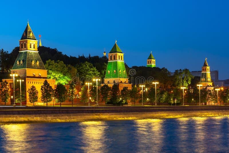 Towers of Moscow Kremlin along Kremlevskaya embankment at night, Russia stock image