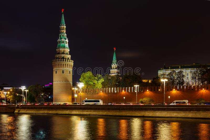 Towers of Moscow Kremlin on a background of Kremlevskaya embankment of Moskva river. Night landscape of Moscow historical center stock photo