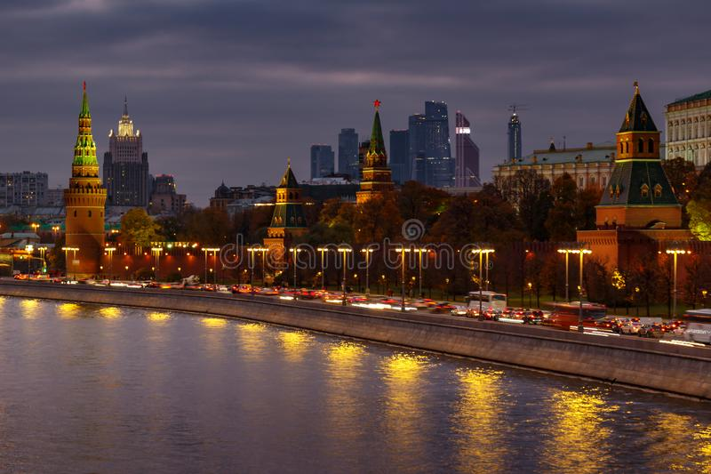 Towers of Moscow Kremlin on a dramatic cloudy sky background in evening royalty free stock image
