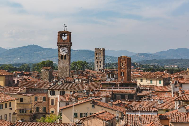 Towers over houses of historic centre of Lucca, Italy. View of towers over houses of historic centre of Lucca, Italy, viewed from the tower of former church of royalty free stock images