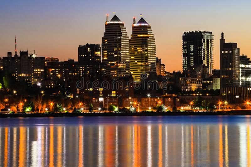 Towers, skyscrapers and buildings in Dnepr city at night, lights reflected on the river Dnieper, Ukraine. Dnipro, Dnipropetrovsk, Dnepropetrovsk stock images