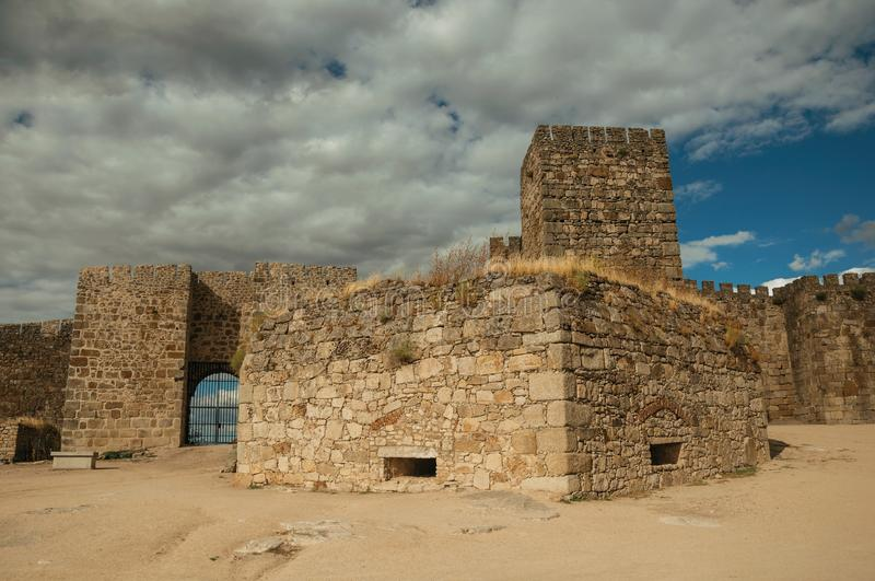 Towers and stone walls facade at the Castle of Trujillo royalty free stock photo