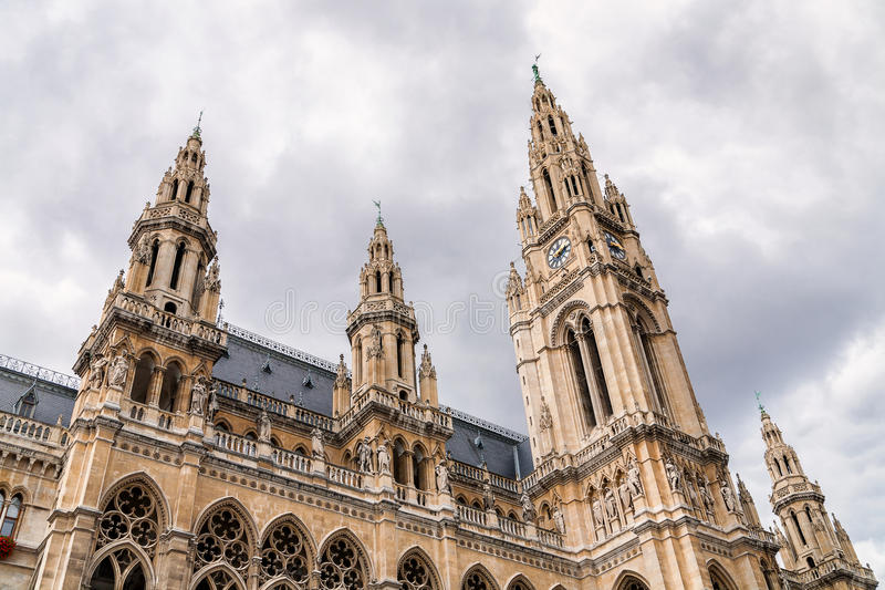 Towers of Vienna City hall, Austria. Towers of Vienna City hall built in historicism style with clouds in background royalty free stock photo