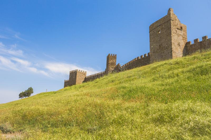 Towers and walls of the Genoese fortress on a high green hill.The City Of Sudak. stock image