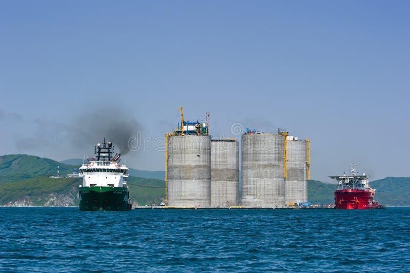 Towing base drilling platform. Nakhodka Bay. East (Japan) Sea. 01.06.2012 royalty free stock photo