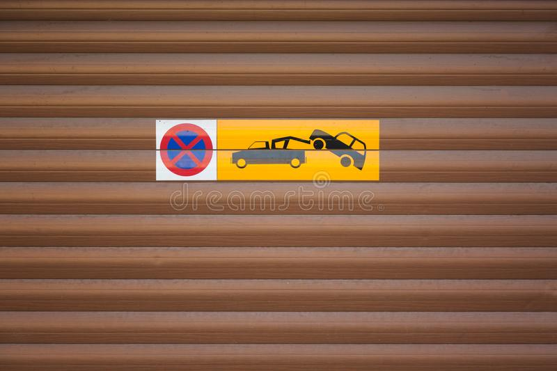 Towing car. Evacuation sign. No parking on wooden background. Towing car. Evacuation sign. No parking on wooden background royalty free stock image