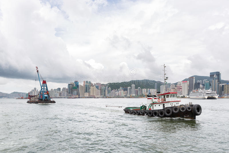 Towing of scrap in Victoria Harbor in Hong Kong. royalty free stock photos