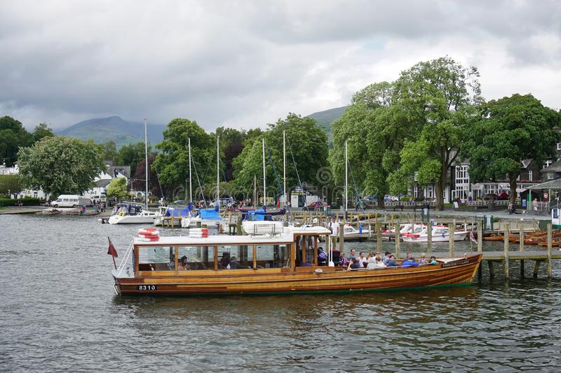 The town of Ambleside on Lake Windermere. AMBLESIDE, UNITED KINGDOM -The town of Ambleside on Lake Windermere is a popular resort in the Lake District in Cumbria royalty free stock image