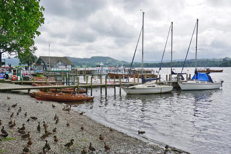 The town of Ambleside on Lake Windermere. AMBLESIDE, UNITED KINGDOM -The town of Ambleside on Lake Windermere is a popular resort in the Lake District in Cumbria stock images