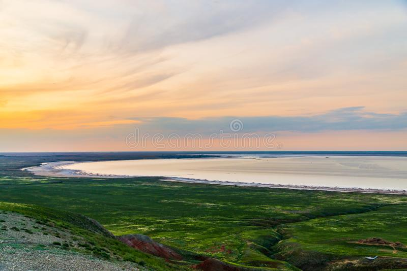 Town on bank of salt lake Baskunchak in Astrakhan region. Beach, bottom, landscape, nature, summer, travel, water, background, beautiful, blue, light, natural royalty free stock photo