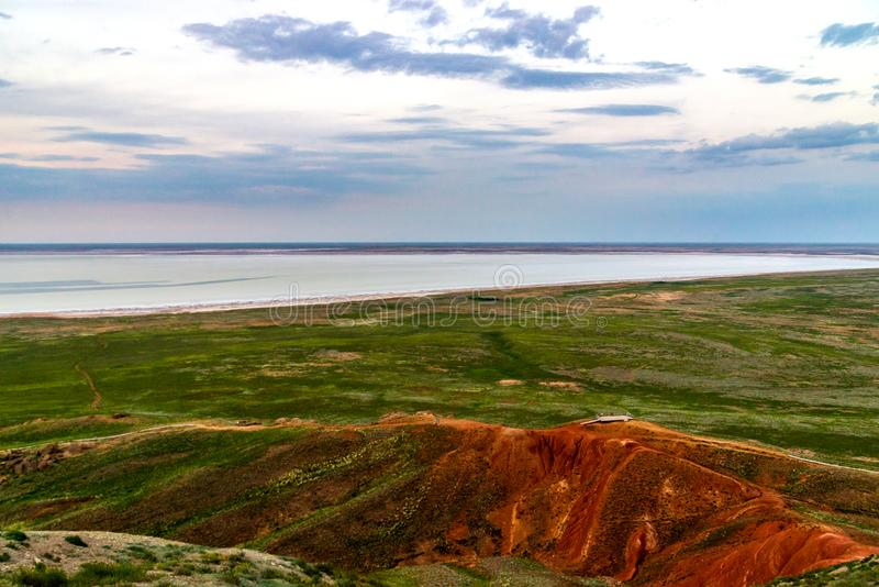 Town on bank of salt lake Baskunchak in Astrakhan region. Beach, bottom, landscape, nature, summer, travel, water, background, beautiful, blue, light, natural royalty free stock photos
