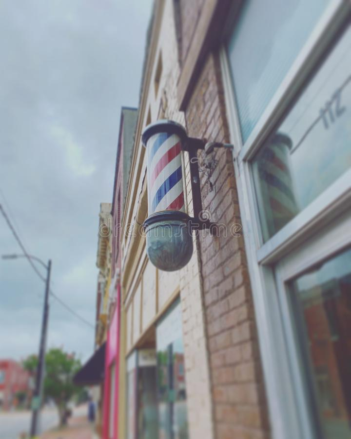 Town Barbershop. Blurred barber shop sign royalty free stock photography