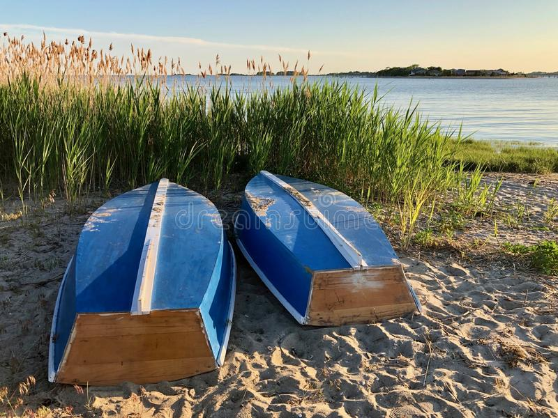Town beach boats in repose stock photo