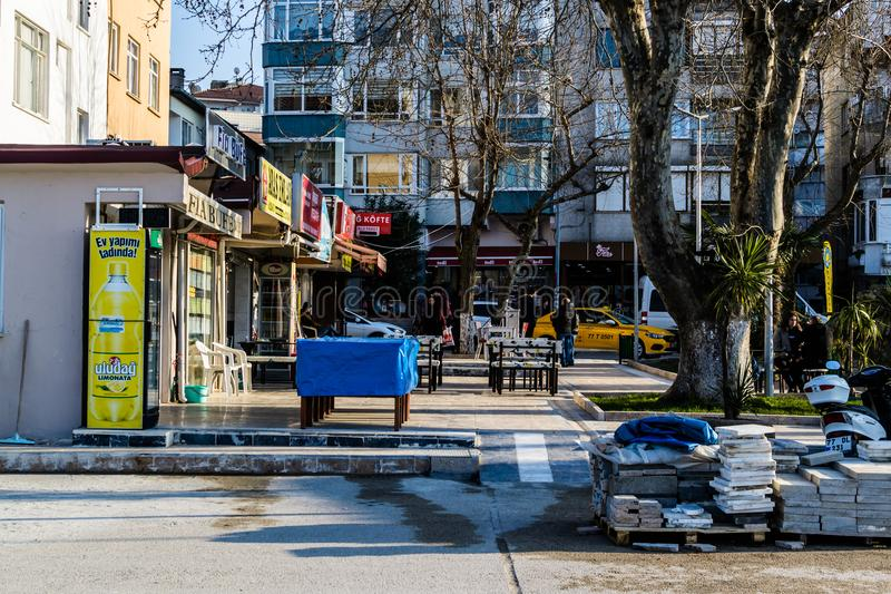 Cinarcik Town Center - Turkey. Town Center of Cinarcik with the view from its everyday life where new apartments, old homes and stores, Turkish tea houses, cafes stock photos